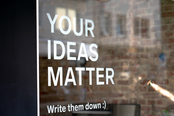 Scottish Games Network. Your Ideas Matter! Write them down :)A motivational quote on a coworking space.