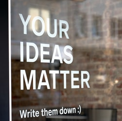 Your Ideas Matter! Write them down :)A motivational quote on a coworking space.
