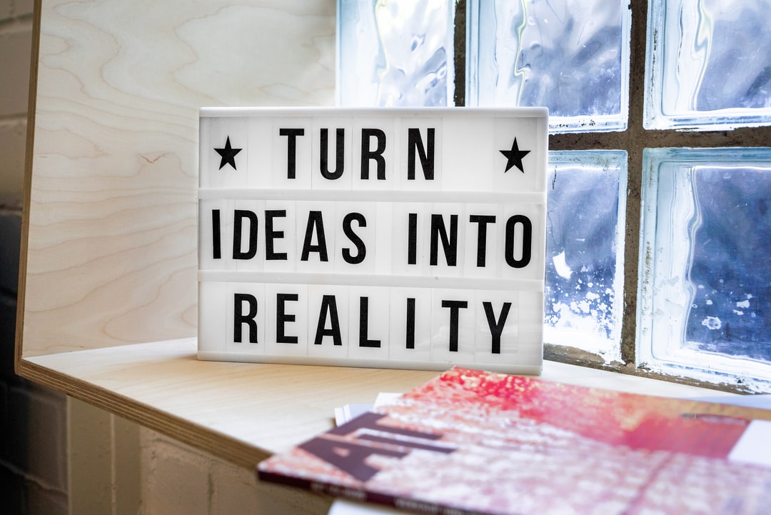 Turn Ideas into Reality! A motivational sign in a Co-Working Space.