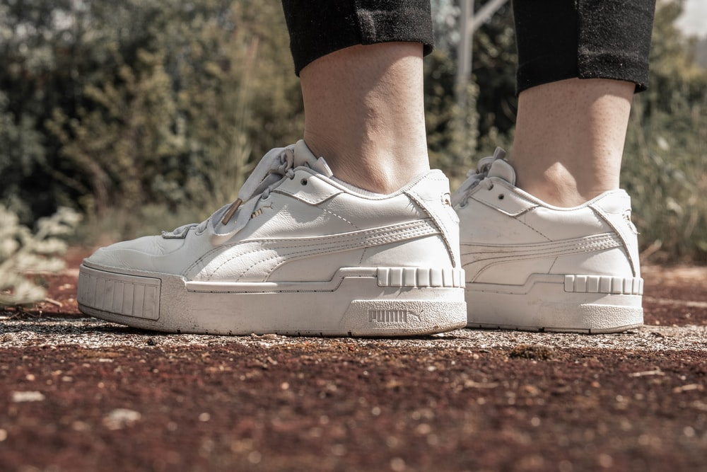 person wearing white nike air max