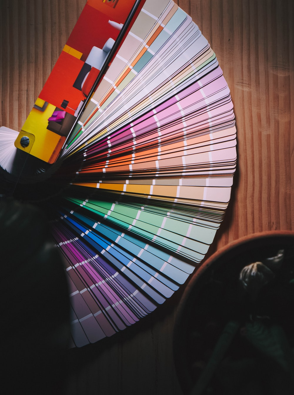 multi colored umbrella on brown wooden table