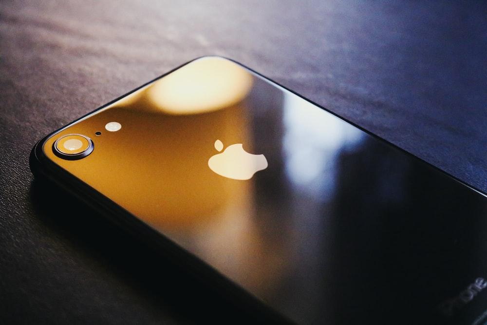 black iphone 7 on black table