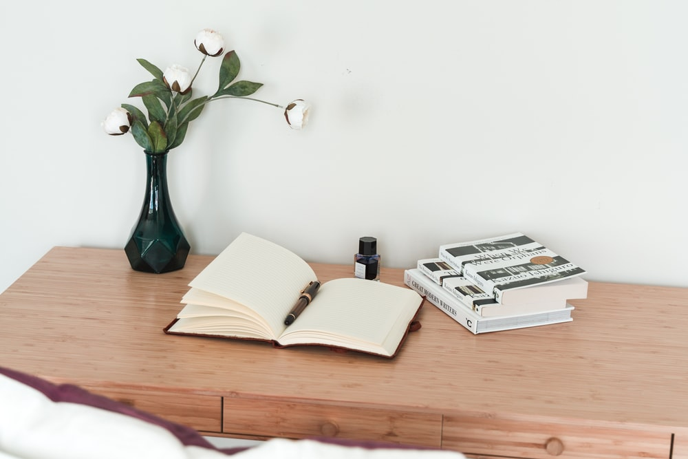 white book on brown wooden table