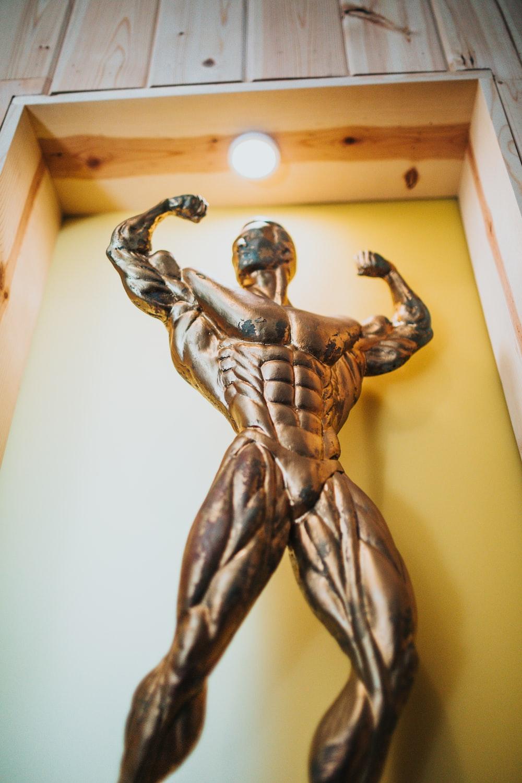 man in gray pants statue