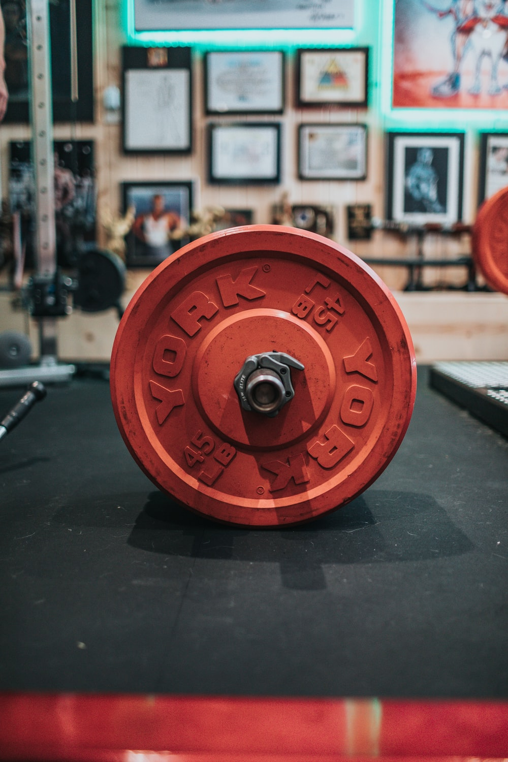red round dumbbell on black table