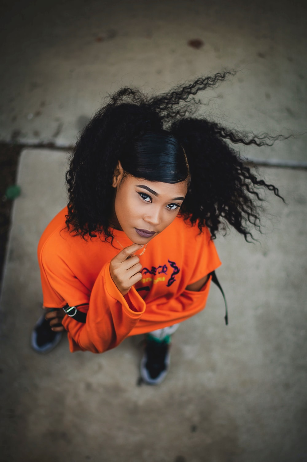 woman in orange long sleeve shirt