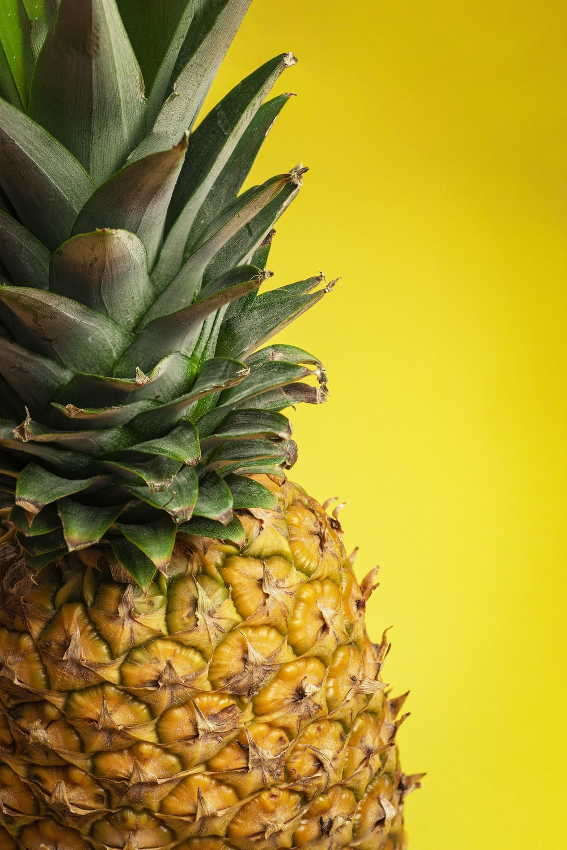 pineapple fruit on yellow surface