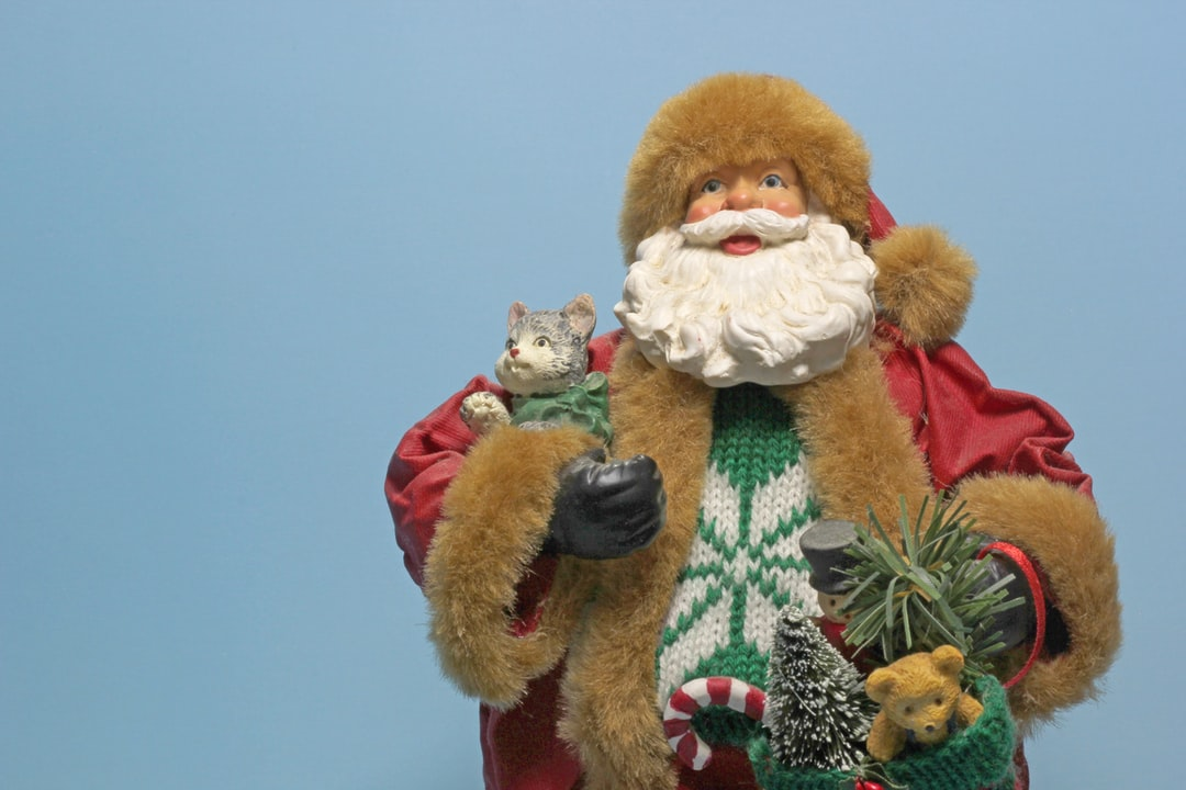 Santa Claus, also known as Father Christmas, Saint Nicholas, Saint Nick, Kris Kringle, or simply Santa, is an imaginary figure originating in Western Christian culture who is said to bring gifts to the homes of well-behaved children on the night of Christmas Eve (24 December) or during the early morning hours of Christmas Day (25 December).