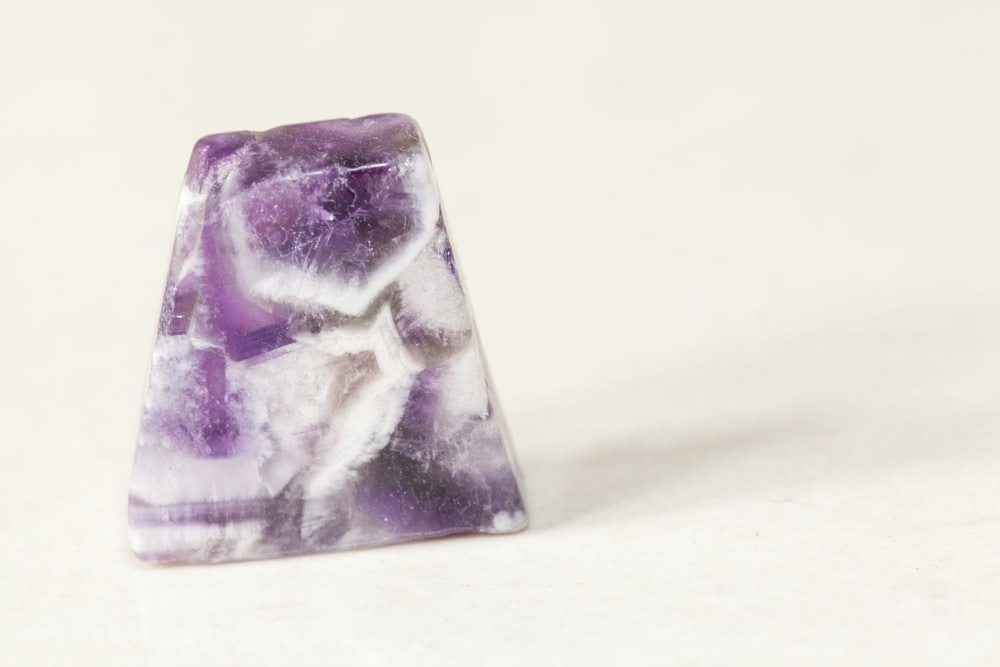 purple and white stone fragment