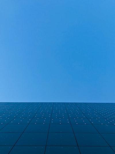 blue sky over black and white concrete building