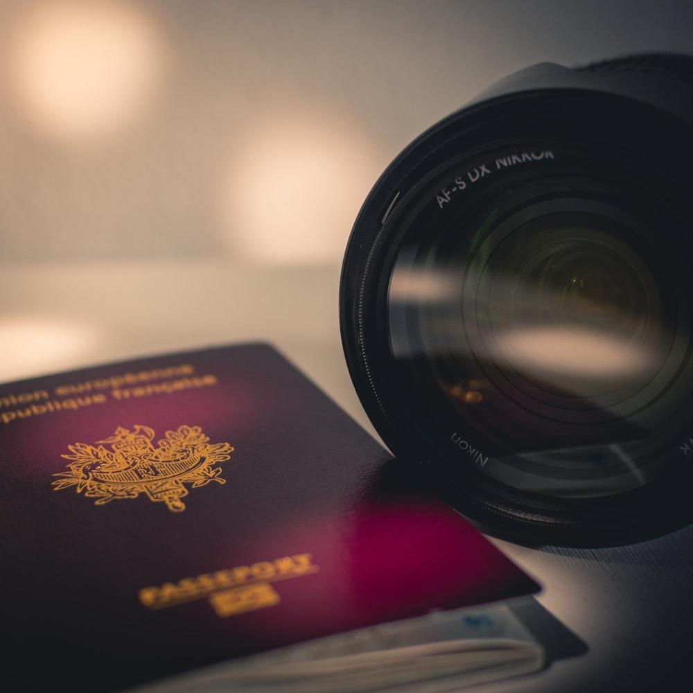 black camera lens on book