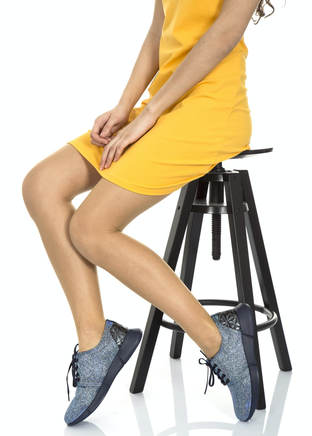 woman in yellow dress sitting on black seat