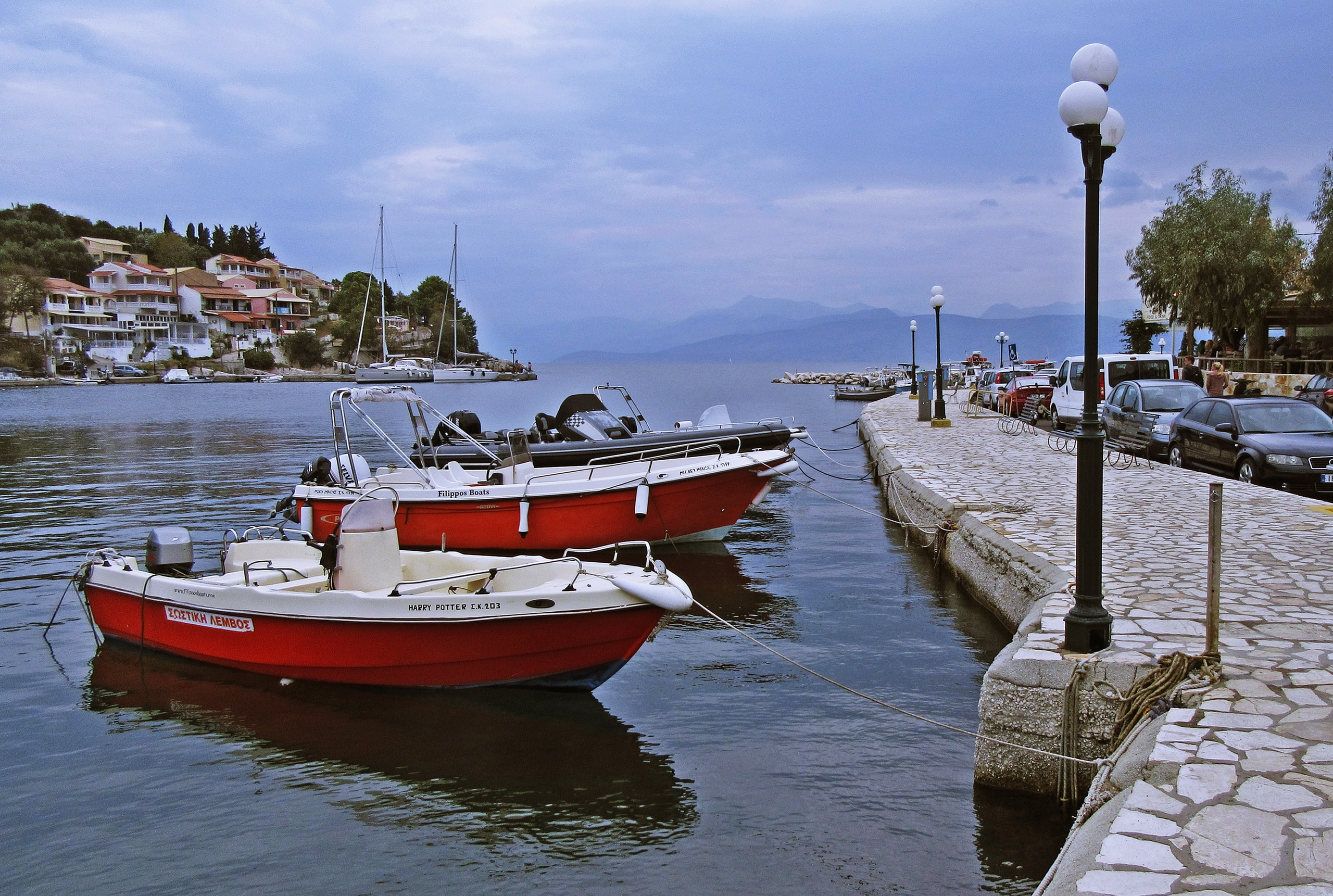 red and white boat on dock during daytime