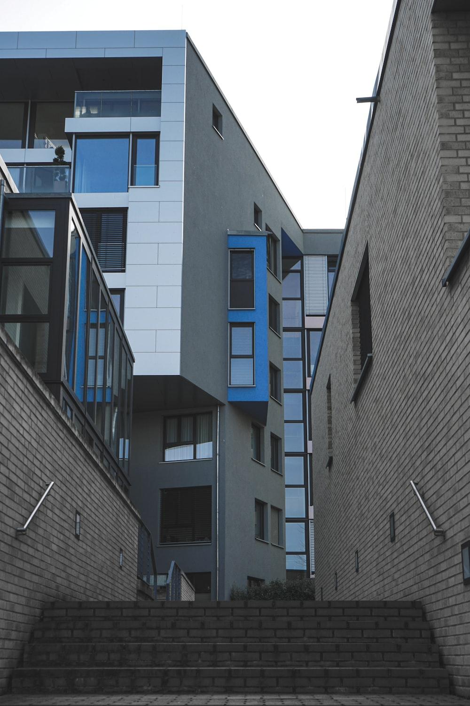 gray concrete building with blue windows
