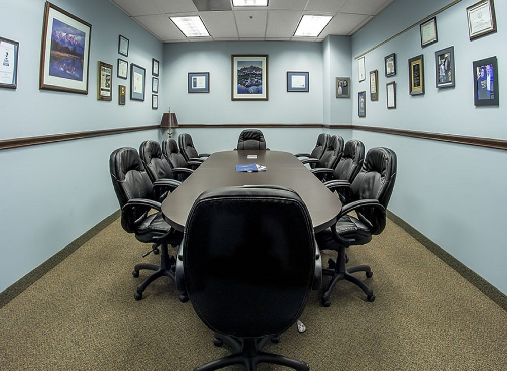 black office rolling chairs on brown carpet