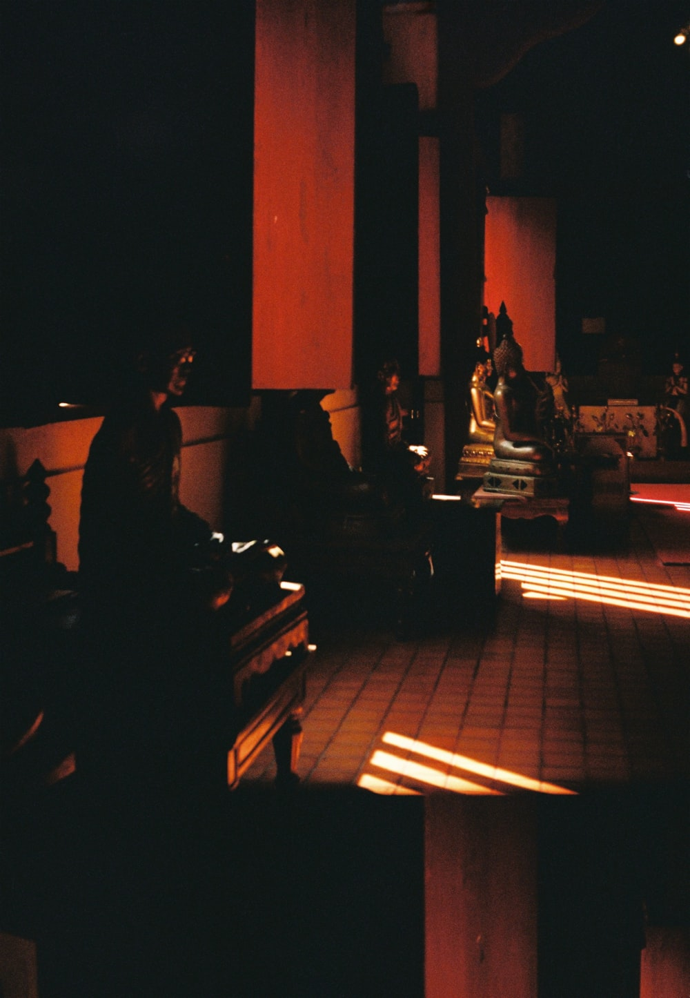 people sitting on bench during night time