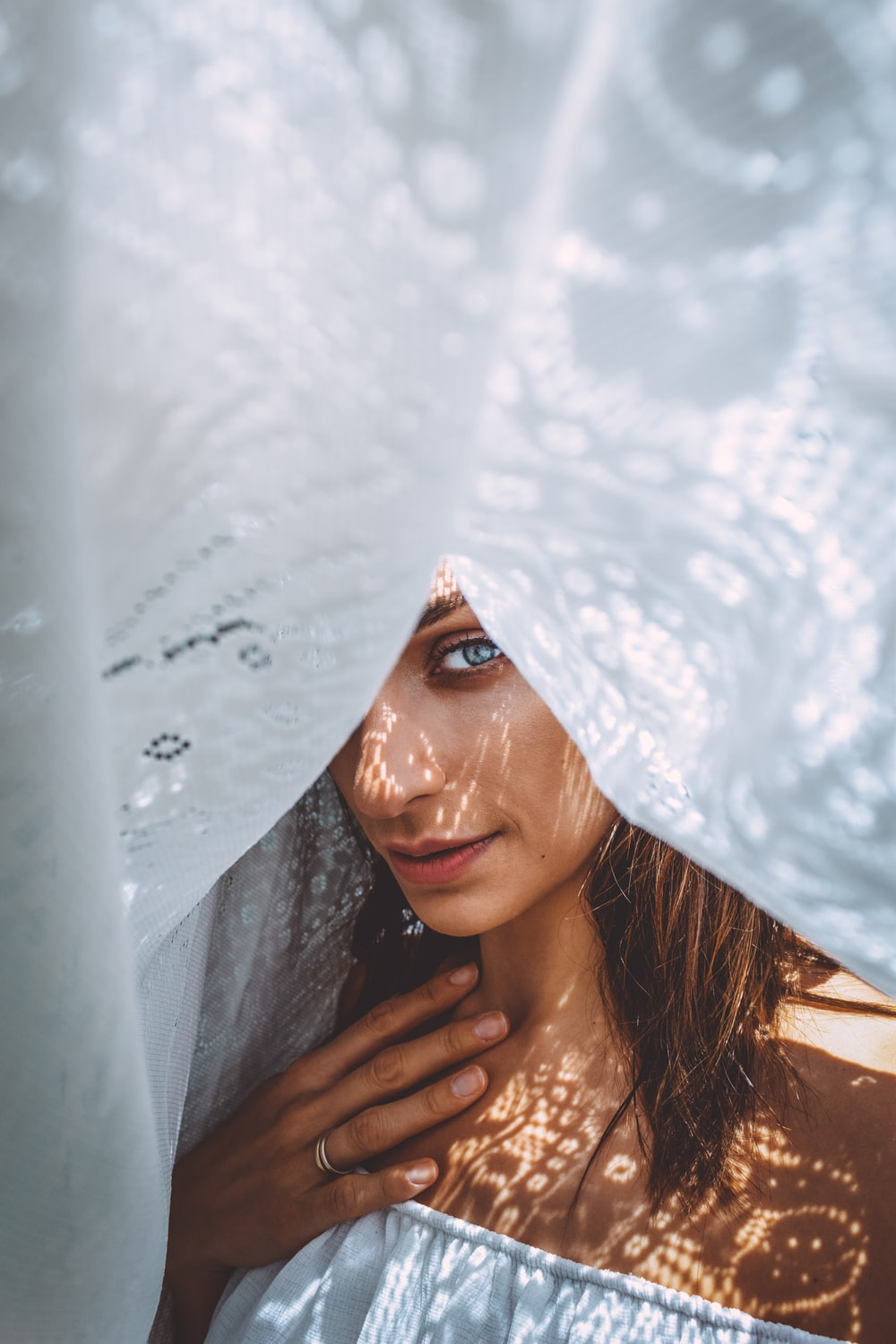 woman in white floral veil