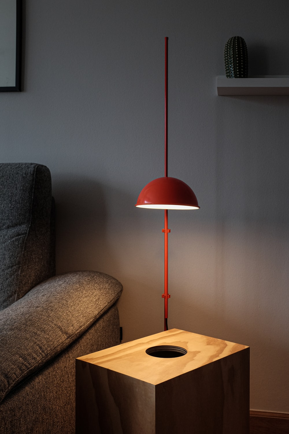 red table lamp on brown wooden table