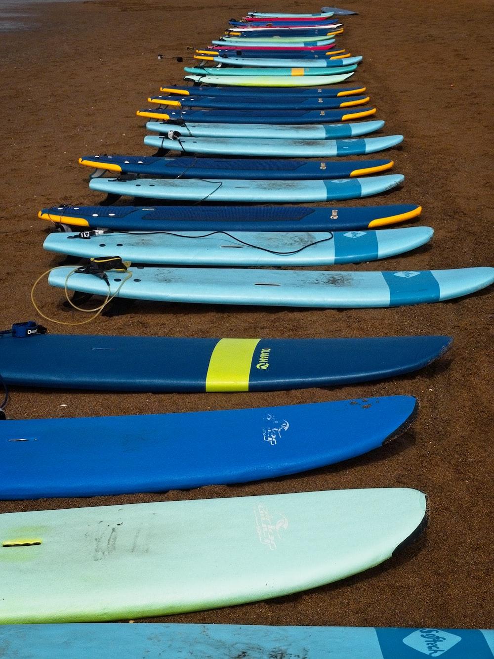 blue and yellow kayaks on brown sand