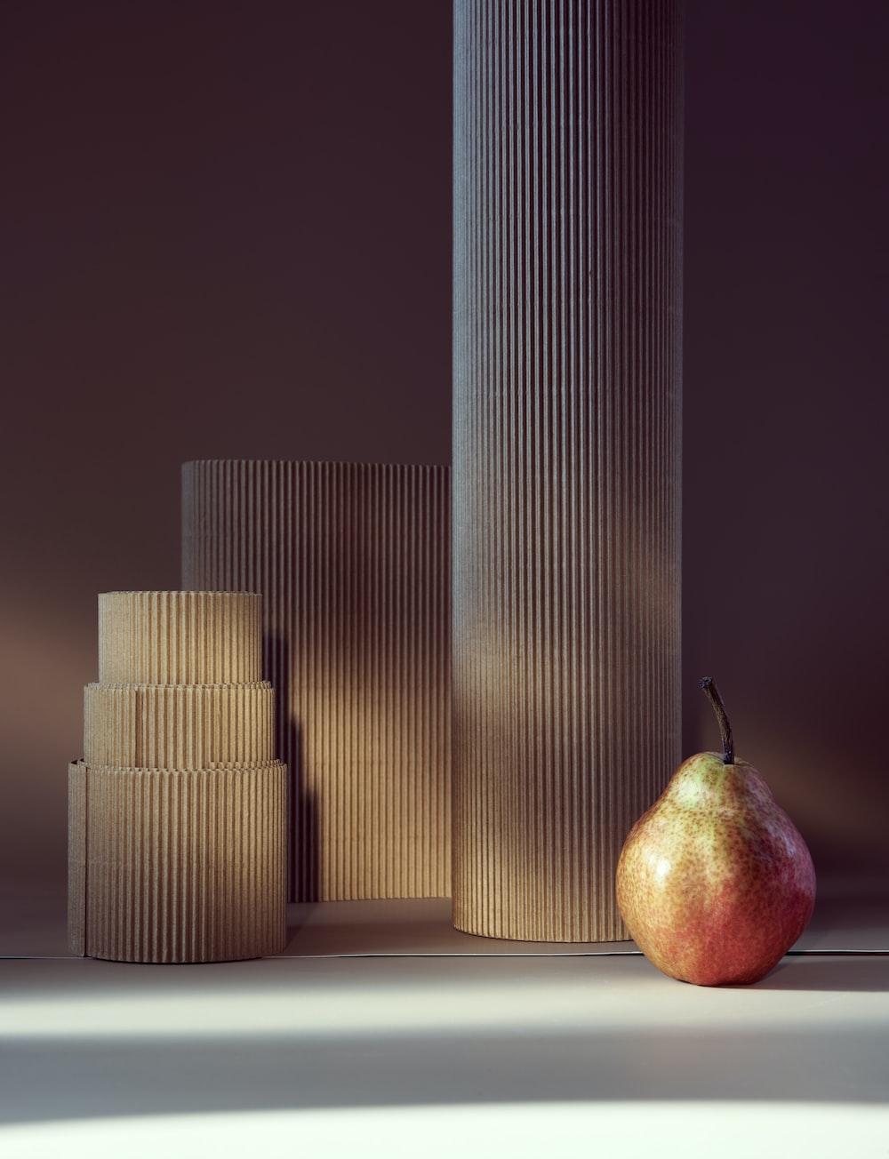 red apple beside gold pillar candles