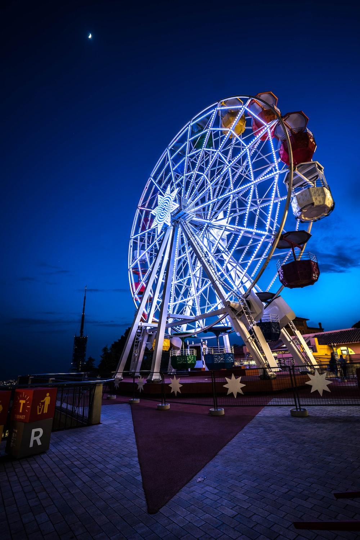 ferris wheel near body of water during night time
