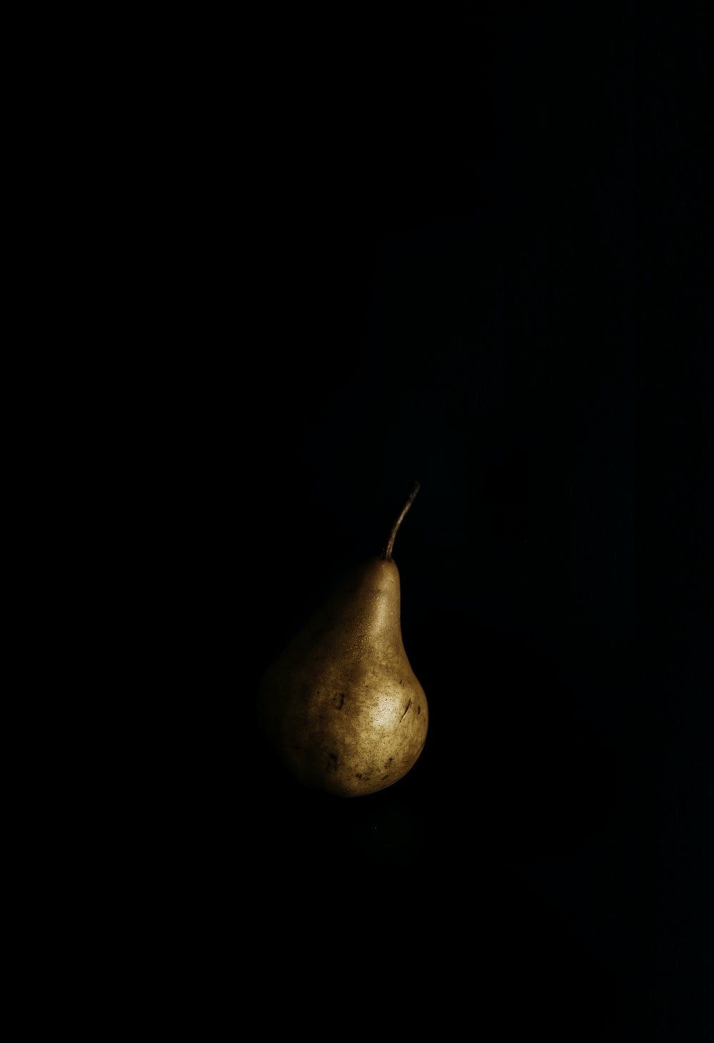 brown and beige fruit with black background