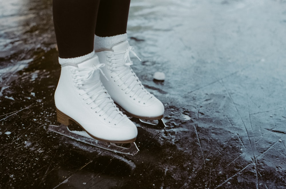 person wearing white leather boots