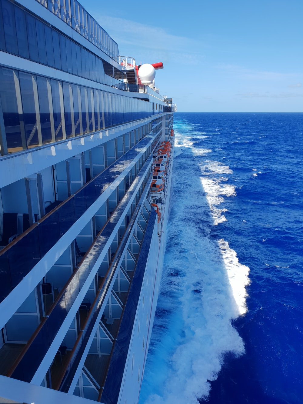 white and blue ship on sea during daytime