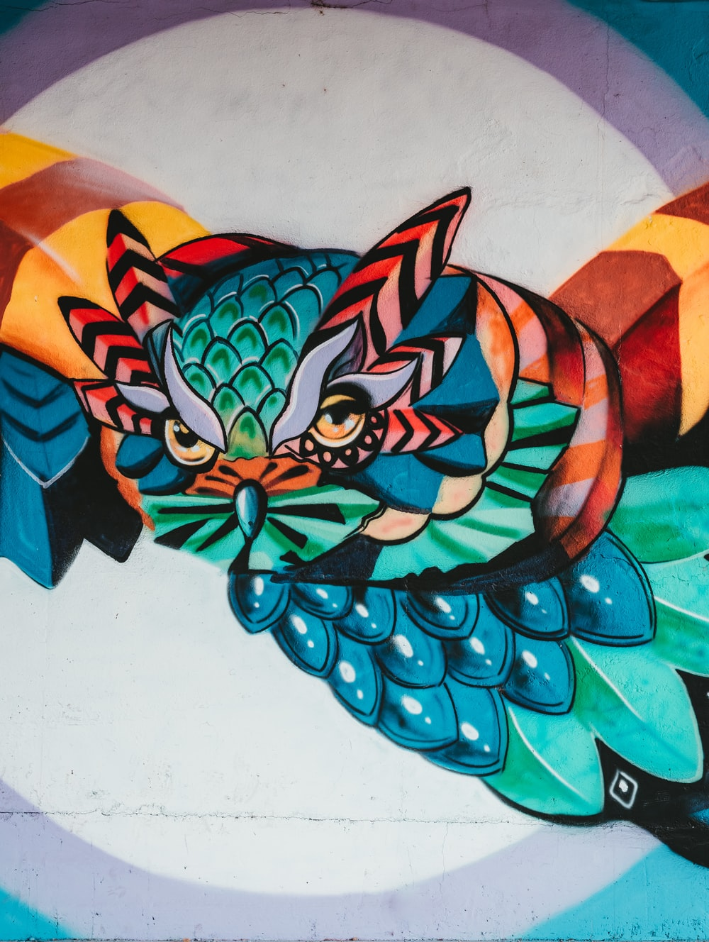 green and orange dragon wall art