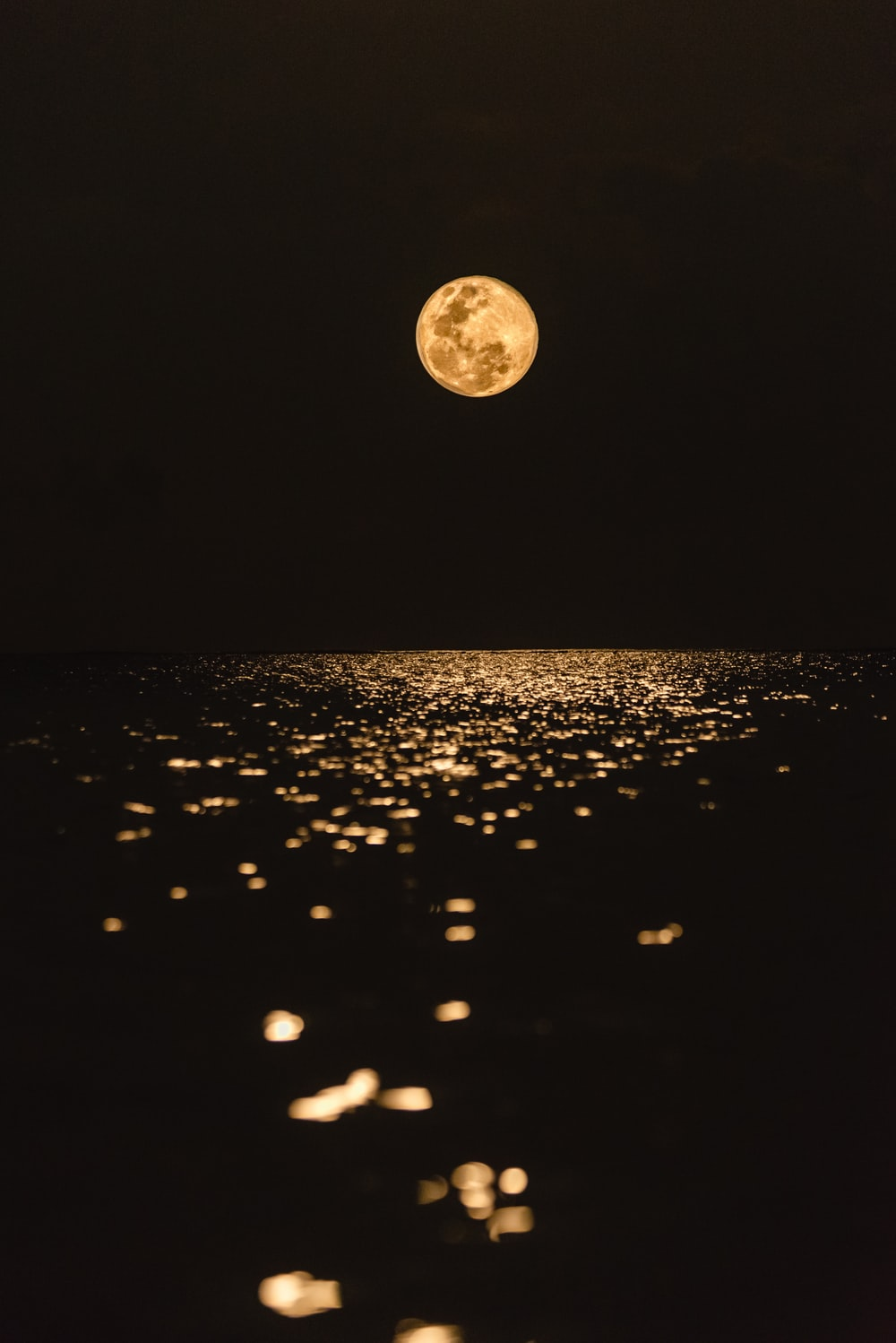 full moon over the body of water