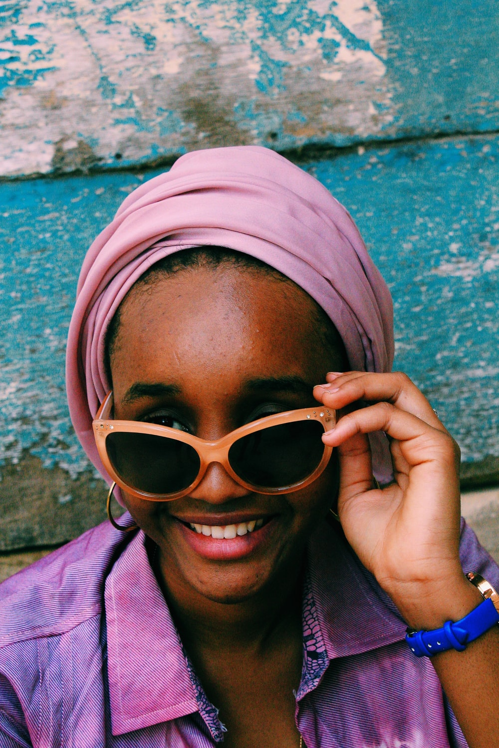 woman in white hijab and brown sunglasses