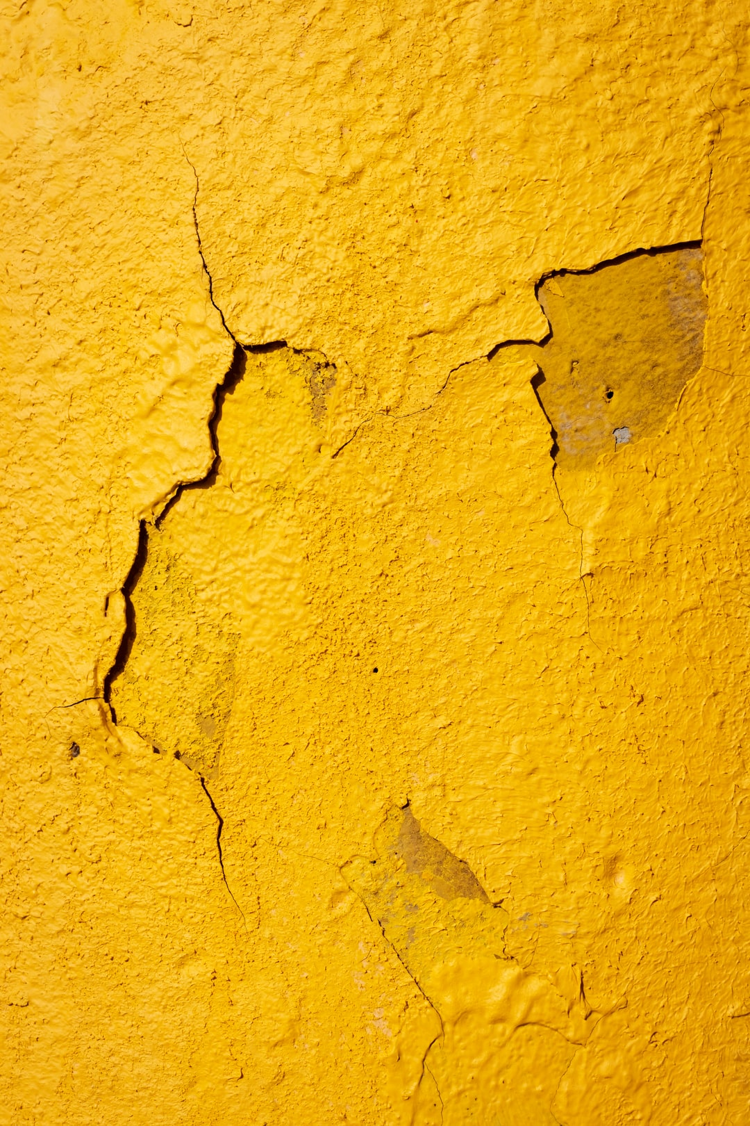 yellow textured cracked paint on wall