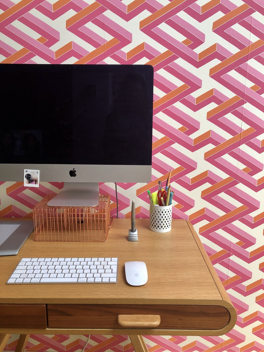 silver imac on brown wooden table