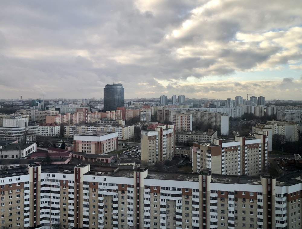 high rise buildings under white clouds during daytime