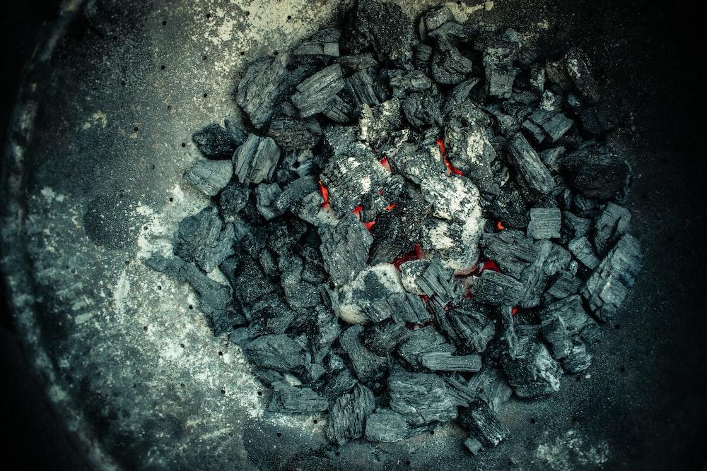 black stones on gray sand
