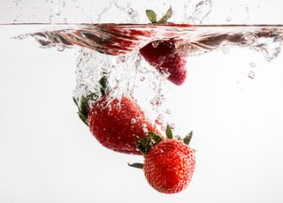 red strawberries in clear glass container