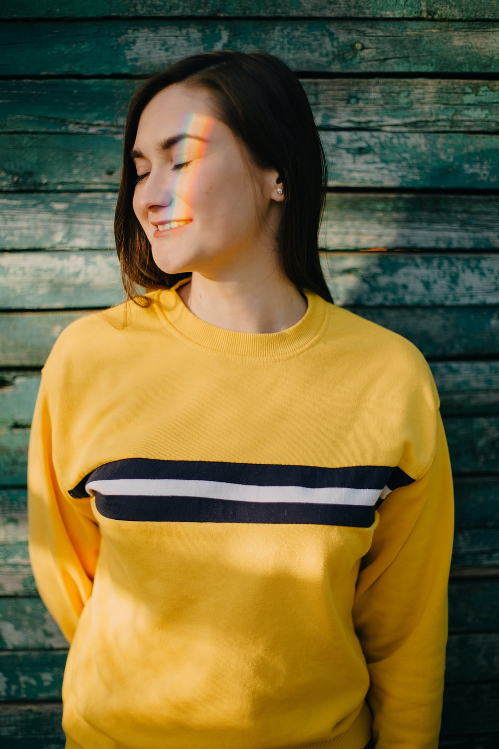 woman in yellow and black crew neck shirt