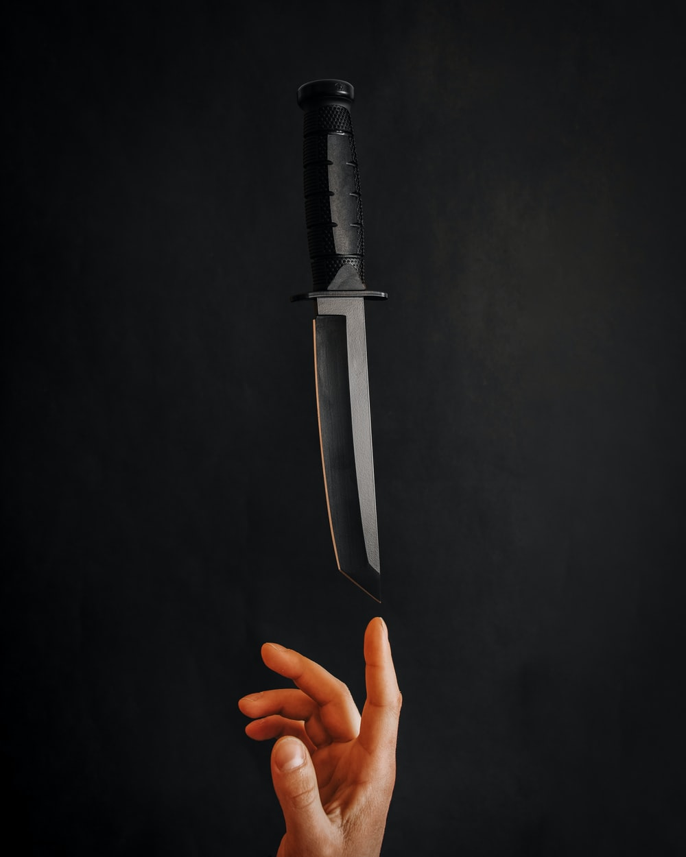 person holding stainless steel knife