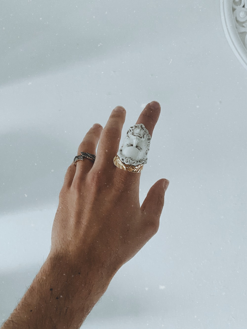 silver and diamond ring on persons finger