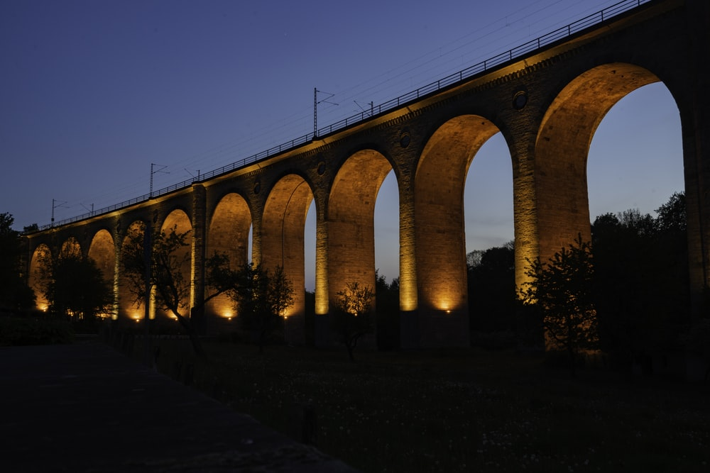 brown concrete bridge during night time