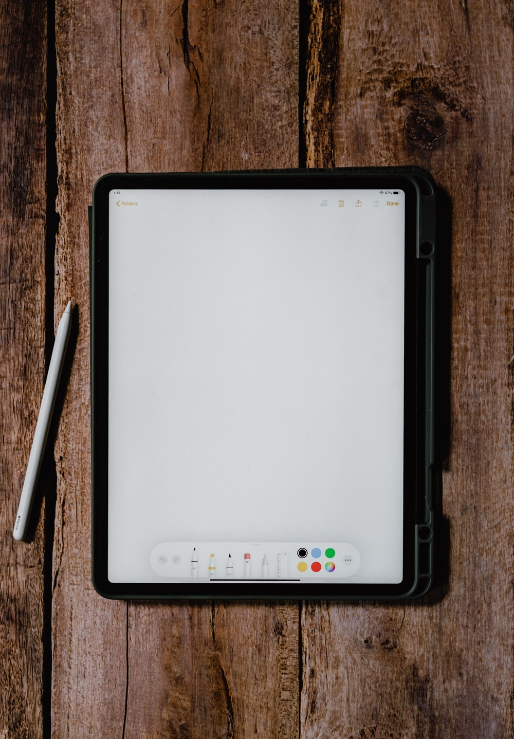 white and black tablet computer