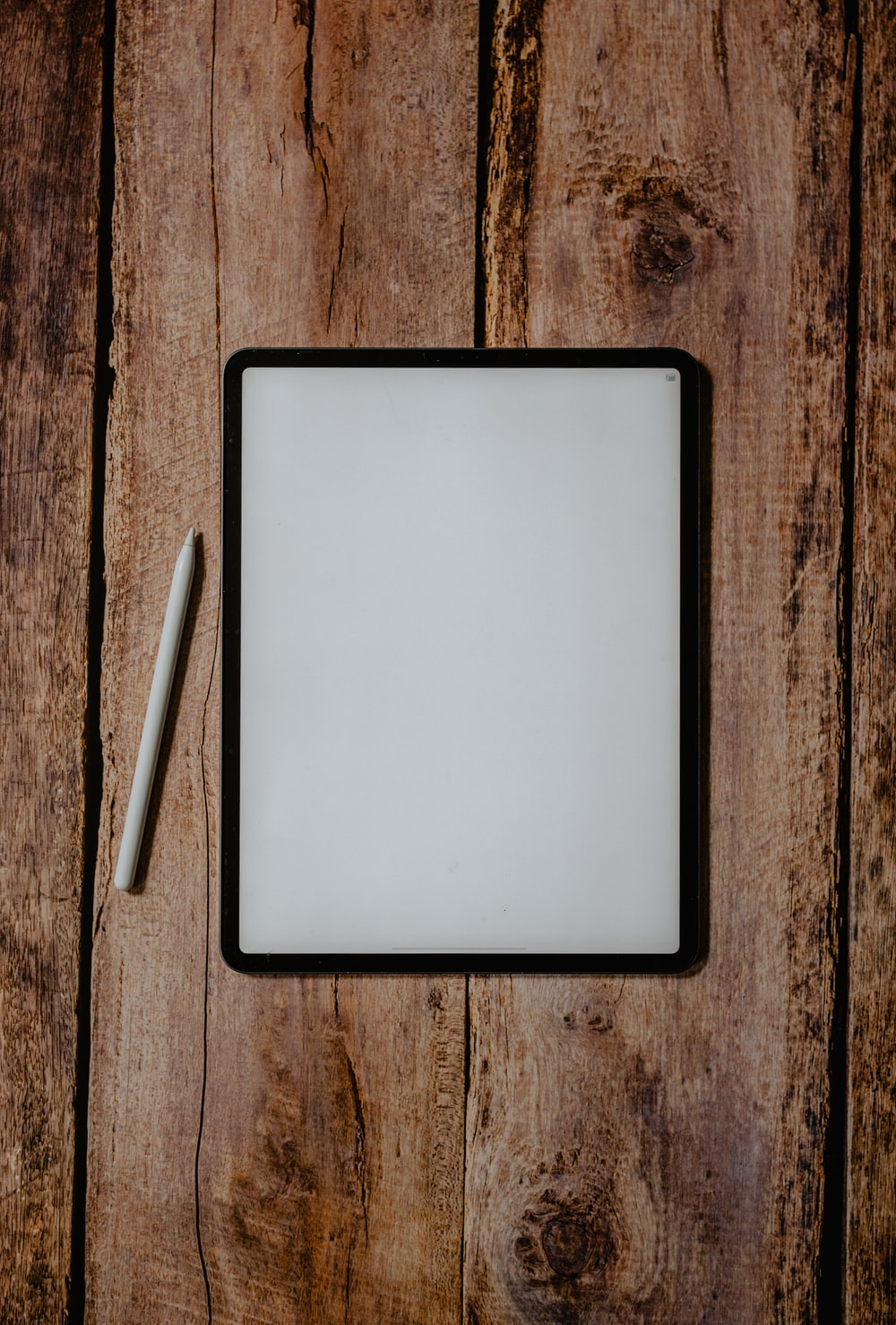white and black board on brown wooden surface