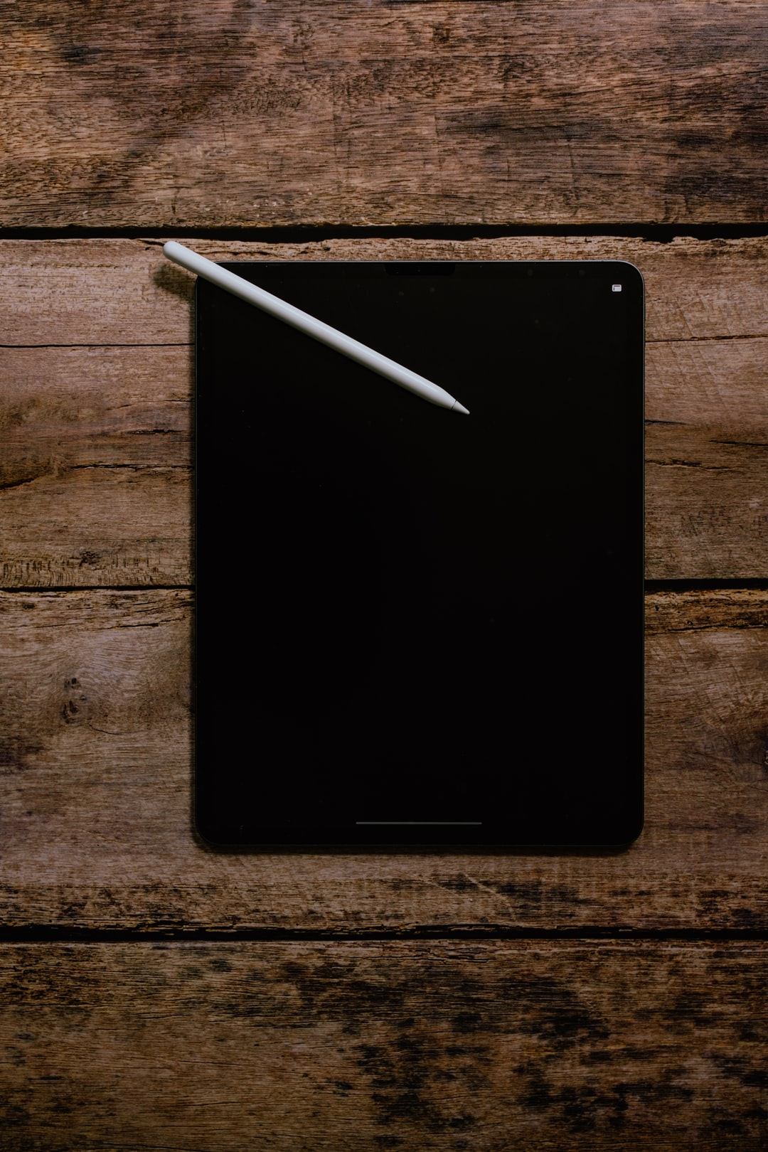 iPad pro with apple pencil and blank black screen
