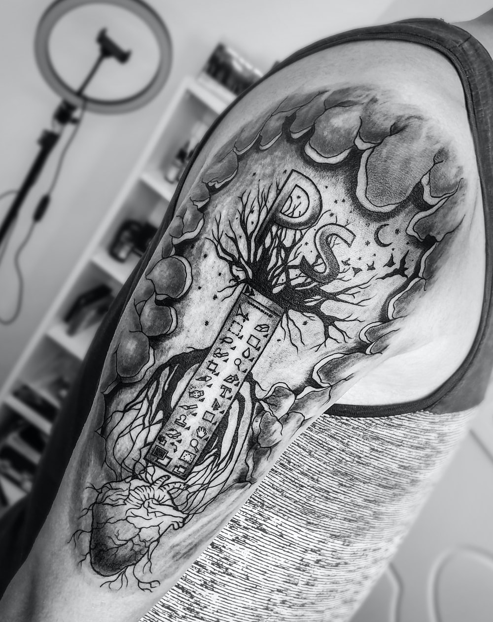 grayscale photo of skull tattoo