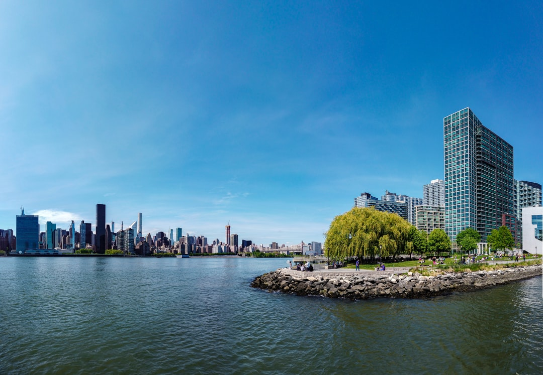 Panorama of the view from Long Island City, in New York City. A blue beautiful day during the epidemic of COVID-19.