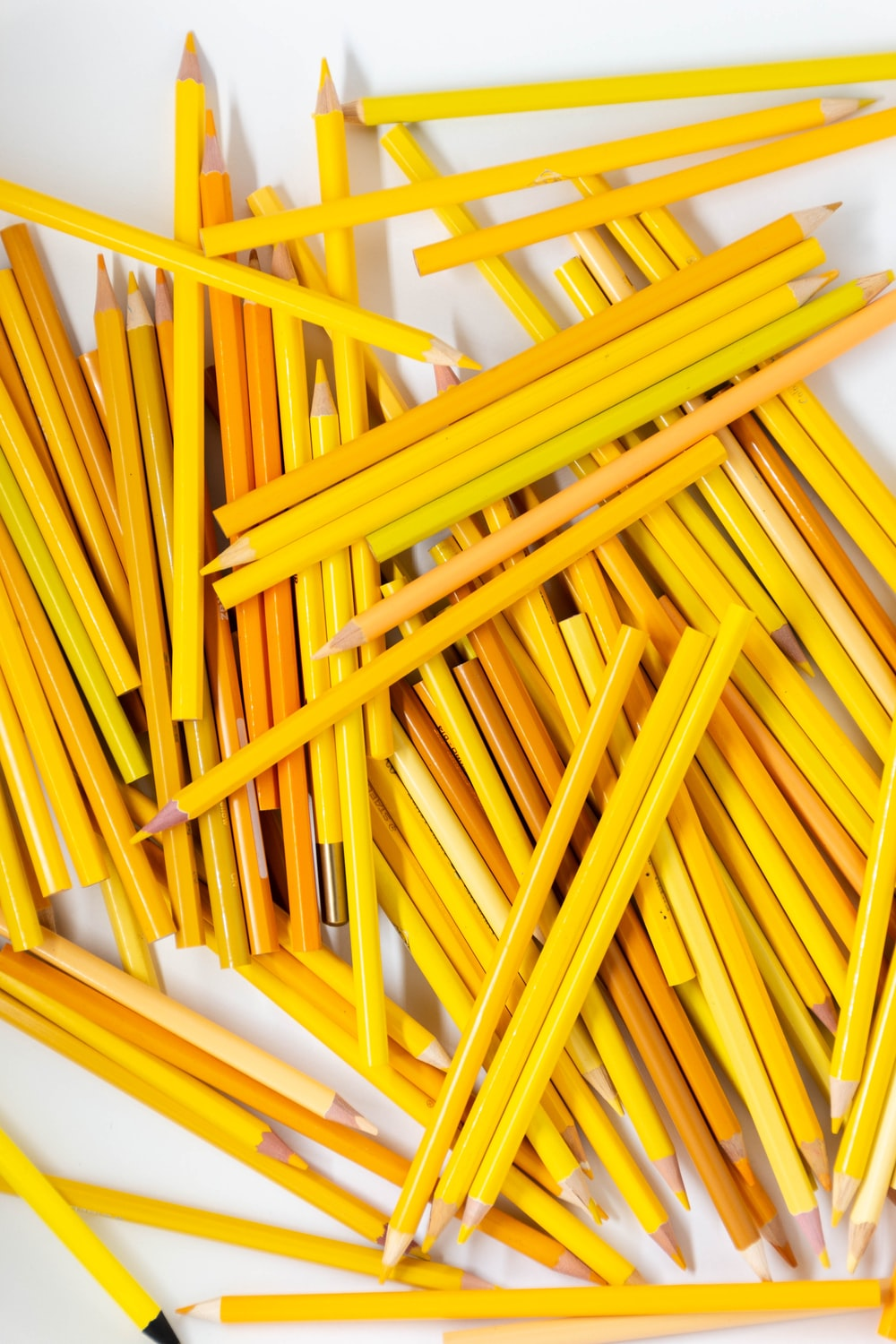 yellow pencils on white surface