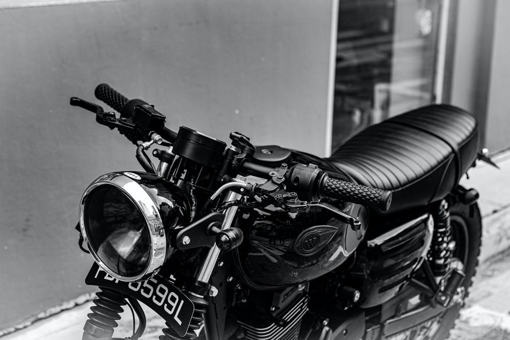 grayscale photo of black motorcycle