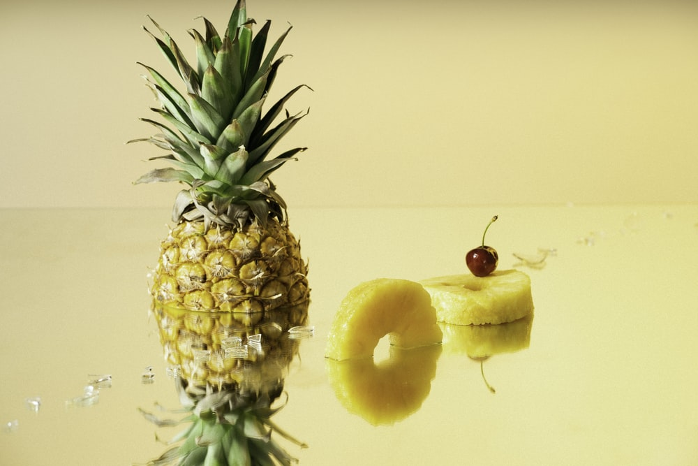 pineapple fruit with red apple fruit