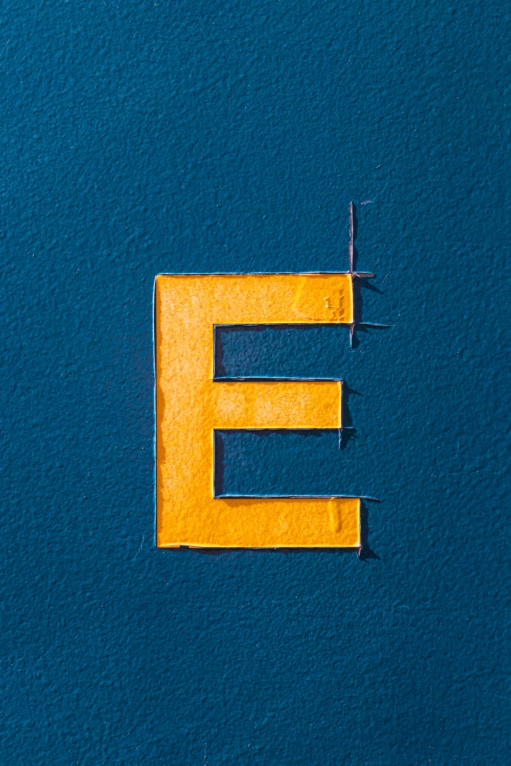 yellow and white letter b wall decor