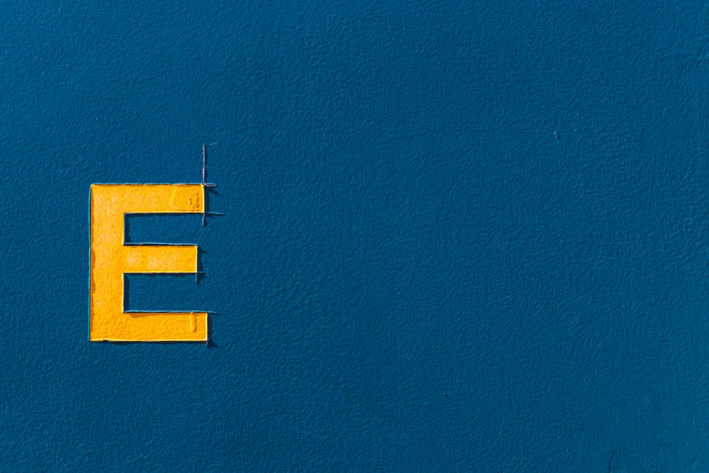blue and yellow letter m